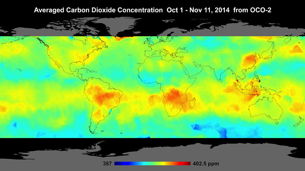 Map of the world with red areas that indicate spots with high levels of carbon dioxide in the atmosphere.