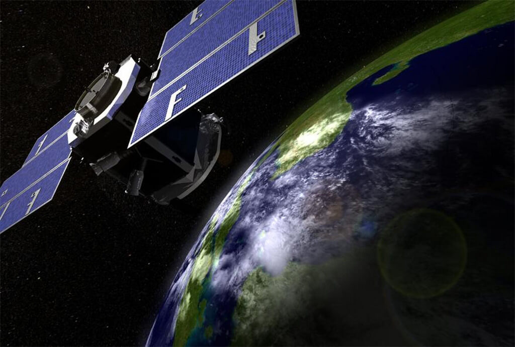 An artist's illustration of NASA's CloudSat spacecraft above the Earth.