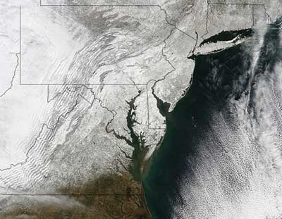 Satellite image of mid-Atlantic states covered with white (snow).
