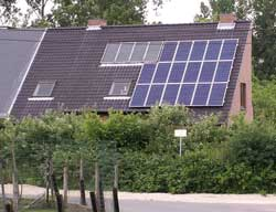 House with solar panels on about half of one side of roof.