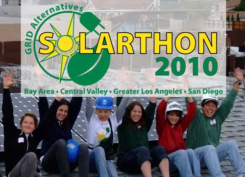Six smiling people raising their arms, solar panels in background, Solarthon 2010 sign superimposed on photo.